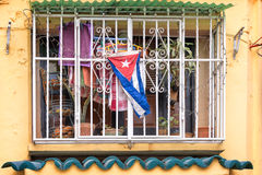 Colorful window with a Cuban flag in Old Havana Cuba. Colorful window with a Cuban flag in Old Havana, Cuba stock images