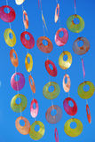 Colorful window decoration. A colorful decoration (circles and rings) hanging on a window royalty free stock photography