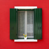 Colorful window with flower pot in Burano Royalty Free Stock Images