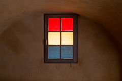 Colorful Window Glass in Masked Red Yellow and Blue in Cellar Stock Images