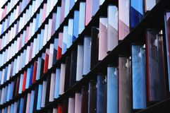 Colorful Window Partitions. Window coverings of various colors in a high rise building stock image