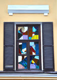 Colorful window. Stained glass window in a colorful tone. Square orientation stock image