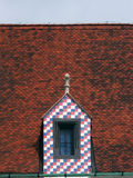 Colorful window on tiled roof Royalty Free Stock Images