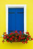 Colorful window on the wall, Burano, Venice, Italy Stock Image