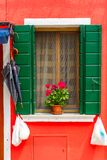 Colorful window on the wall, Burano, Venice, Italy Stock Images