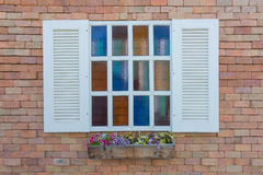Colorful window on the wall. Royalty Free Stock Image