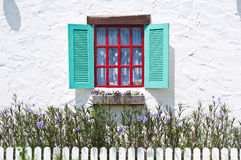 Colorful window on white wall Royalty Free Stock Photography