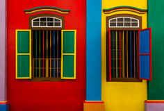 Colorful Windows. Architecture detail of two colorful windows on a colorful wall Stock Images