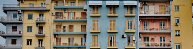 Colorful windows in a building. A picture of different colorful windows in a building,in a greek town Thessaloniki,in a day afternoon of february royalty free stock photos