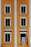 Colorful windows of the building in Salzburg. stock photos