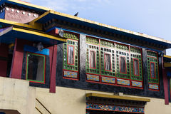 Colorful windows detail with sunlight of Rumtek Monastery in winter near Gangtok. Sikkim, India Royalty Free Stock Photo