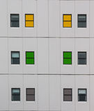 Colorful windows of a multistory building Royalty Free Stock Image