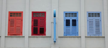 Colorful windows at old house in Singapore Stock Photo