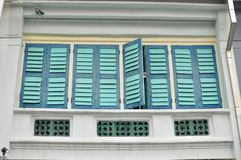 Colorful windows on a shop house in Penang, Malaysia.  Royalty Free Stock Photos
