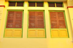 Colorful windows on a shop house in Penang, Malaysia.  Stock Image