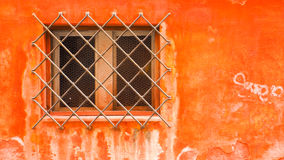 Colorful windows with the steel protection of the building in Venice Stock Photo