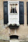 Windows and window boxes planters displays adornments enhance architecture. Colorful windows and window boxes planters displays adornments enhance architecture stock photos