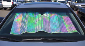 Colorful Windshield Shade. Colorful foil shade inserted inside windshield Royalty Free Stock Images