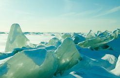 Colorful winter landscape with crystal cracked ice, deserted surface of frozen sea. stock image