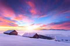 Colorful winter sunrise in the Carpathian mountains Stock Photos