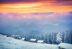 Colorful winter sunrise in fogyy mountains. Royalty Free Stock Photos