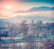 Colorful winter sunrise in the mountain village Royalty Free Stock Image