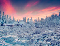 Colorful winter sunrise in the mountain village. Stock Photos