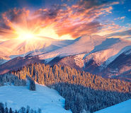 Colorful winter sunrise in the mountains. Dramatic sky. Stock Photos