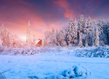 Colorful winter sunset in mountain village. Stock Photography