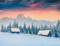 Colorful winter sunset in old farm in mountains Stock Image