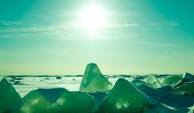 Colorful winter sunset over the cracked crystal ice with sun lights inside. royalty free stock photos