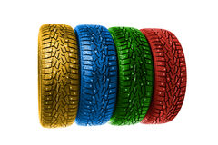 Colorful winter tires on white Stock Photos