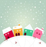 Colorful winter village Stock Images
