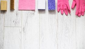 Pink and violet cleaning supplies with design space stock photography