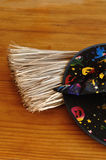 A colorful witches hat and a broom Royalty Free Stock Photography