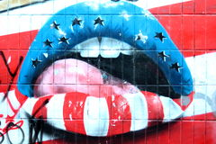 Colorful woman lips graffiti. Graffiti of a beautiful colorful woman lips on wall in Kiev, Ukraine royalty free stock images