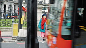 Colorful woman in London at traffic lights stock video footage