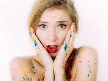 Colorful woman in paint portrait  with red lips Royalty Free Stock Photography