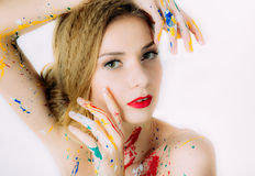 Colorful woman portrait with hands near the eyes in paint Royalty Free Stock Photo