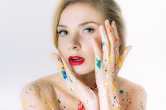 Colorful woman portrait with hands near the head with red lips Royalty Free Stock Image