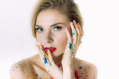 Colorful woman portrait with hands near the head Royalty Free Stock Images