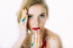Colorful woman portrait with hands near the head Royalty Free Stock Photo