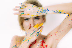 Colorful woman portrait in paint  with hands closing mouth Stock Photography