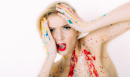 Colorful woman portrait in paint with red lips with regret fa Royalty Free Stock Images