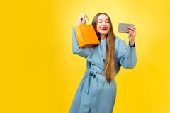 Colorful woman portrait with shopping bag Royalty Free Stock Photos