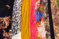 Colorful woman scarves in a row Stock Image