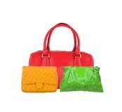 Colorful women bags isolated on white Royalty Free Stock Photography