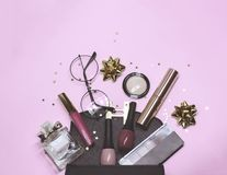 Colorful cosmetic set on violet background with stars and gift bow, flat royalty free stock photos