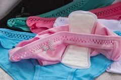 Colorful women`s panties and sanitary pads royalty free stock images