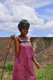Colorful women with stick in Madagascar. Shepard for zebu Stock Images
